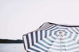 Blue white striped beach parasol