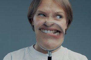 portrait of caucasian wooman with magnifier