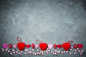 bright red hearts on the gray concrete background
