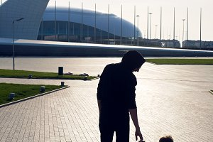 child walks with his father in the Park on the square in Sochi