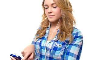 Teen searching music with smartphone
