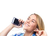 Teen listening music with smartphone