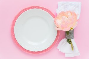 Pink table place with peony