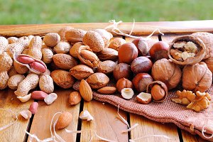 Nuts on a wooden table in field