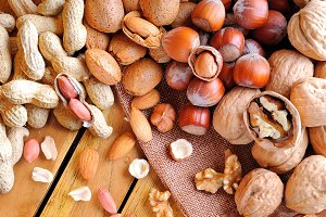 Nuts on a wooden table top view
