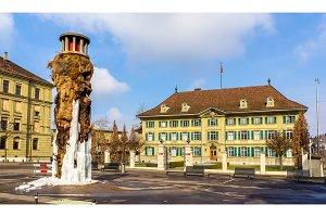 Frozen Meret Oppenheim Fountain and Police office in Bern, Switz