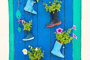 Old children rubber boots on door