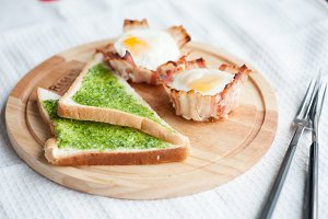 Pesto on toast and egg in bacon for breakfast.