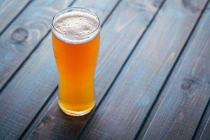 Pale ale on blue wood