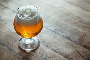 Snifter beer glass on wood