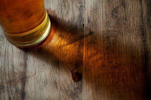 Beer glass cuastics on wood