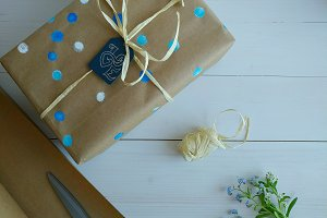 Wrapped gift in brown craft paper.