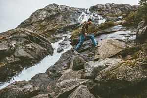 Man climbing in rocky mountains