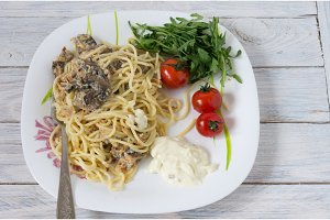Dish of pasta and mushrooms. Fried mushrooms and vegetables.