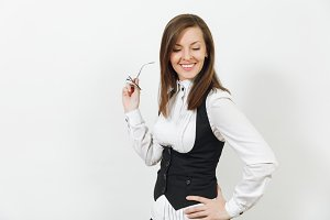 Beautiful happy caucasian young smiling brown-hair business woman in black suit, white shirt and glasses looking down isolated on white background. Manager or worker. Copy space for advertisement.