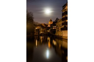 Moon over Ill river in Petite France area, Strasbourg - Alsace,