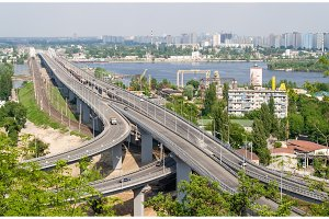 View of highway and railway bridges from a hill over the Dnieper