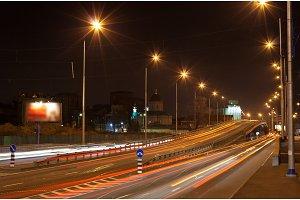 The bridge of a traffic interchange at night