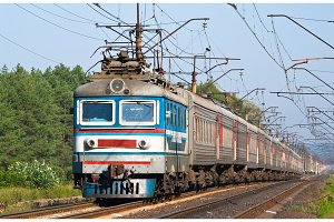 Passenger train hauled by electric locomotive. Ukraine railways