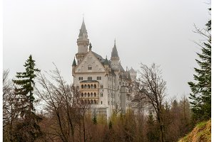 Neuschwanstein Castle in a fog - Bavaria, Germany