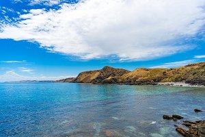 Mountain coastline with deep blue ocean water landscape
