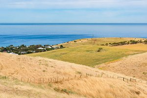 Spectacular landscape with rolling hills and sea on sunny day