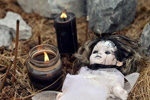 Voodoo doll and black candles