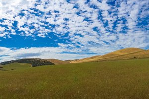 Picturesque landscape of vast hills and sky