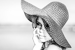 Cute girl in a hat. Black and white