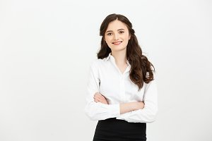 Businss Concept: Portrait confident young businesswoman keeping arms crossed and looking at camera while standing against grey background