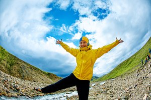 happy woman in the mountains, Iceland