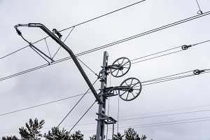 Catenary wires for power supply to railway against sky