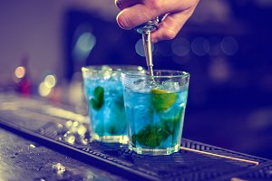 Bartender is pouring blue syrup