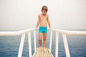Small boy enjoying summer vacation on sea