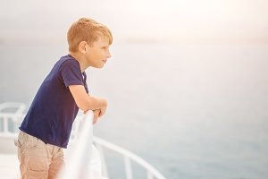 Small boy enjoying summer vacation on sea