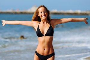 Blond woman on tropical beach