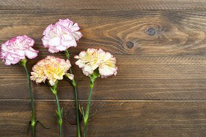 Yellow flowers on wooden table. Decor.