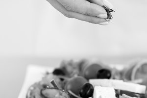 Closeup on woman adding fresh dill into salad