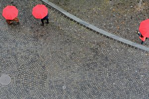 Three Red Umbrellas Cobblestone