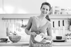 Smiling young housewife serving breakfast tray