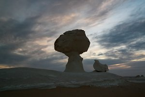 Abstract nature rock formations aka sculptures Chicken under the tree in White desert, Sahara, Egypt