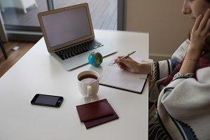 Girl sitting at her desk, planning