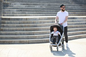 Father with a baby stroller