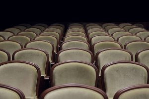 Rows of velvet theater seats