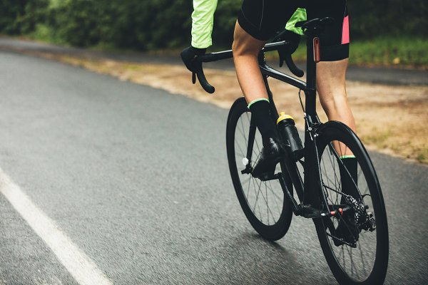 Sports Stock Photos: Jacob Lund Photography - Athlete cycling on country road