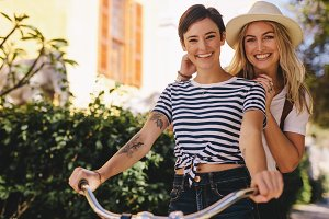Best friends enjoying bicycle ride