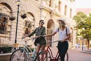 Friends walking with bicycles