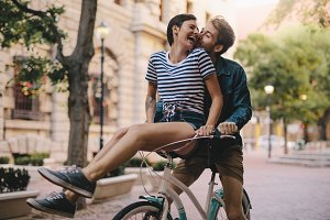 Couple having fun on a bicycle