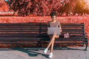 Girl with laptop, vivid colors