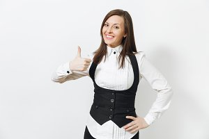 Beautiful happy caucasian young smiling brown-hair business woman in black suit, white shirt and glasses showing thumb up isolated on white background. Manager or worker. Copy space for advertisement.